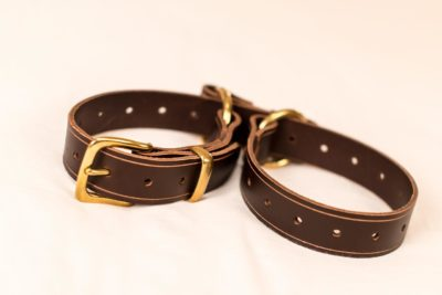 Handmade leather belt that's easily converted to a restraint system? Yes, please.