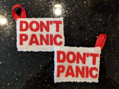 "These ""DON'T PANIC"" keychain towels – so you always know where your towel is."