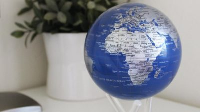 Solar powered rotating globe decor