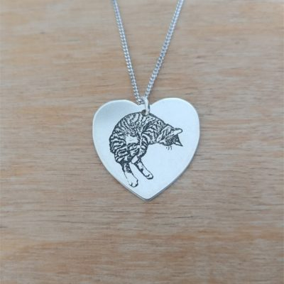 A Heart Necklace with your pet(s) engraved on it! Or maybe yourself ❤