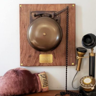 8″ brass ringside boxing bell on plaque with spring-triggered striker & pullchain for loud, authentic sounding ring