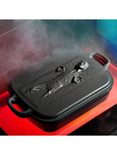 A Le Creuset cast iron roaster with Star Wars' Han Solo frozen in carbonite on the lid.